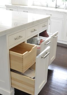 Kitchen design idea: keep a bank of drawers uniform by concealing two drawers behind one drawer face.