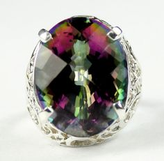 SR291, 20x15mm, 22ct Mystic Fire Topaz, 925 Sterling Silver Ring  * Stone Type - Mystic Fire Topaz * Approximate Stone Size - 20x15mm  * Approximate Stone Weight - 22 cts  * Jewelry Metal - Solid 925 Sterling Silver * Approximate Metal Weight - 4.2 grams  * Ring Size - Size selectable during checkout * Our Warranty - A full year on workmanship  * Our Guarantee - Totally unconditional 30 day guarantee