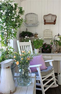 <3 birdcages on wall & the old white rocker & the chippy white ironstone pitcher AND... -Kathy H