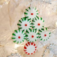 Easy Christmas Ornaments Kids Can Make - With a little crafting glue, glitter, ornament balls, and paper, you can make Christmas ornaments for the tree while building lasting holiday memories with your kids. These ornaments are fun and easy for everyone to create!