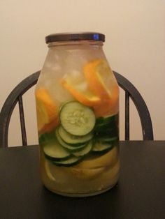Amazing detox drink ~ drink this to get energy & lose weight easily & fast: 2 lemons, 1 cucumber & 1 orange fill with fruit, ice then water keep in fridge overnight & drink the next day.