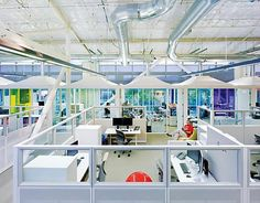 "Google open plan office. Giant ""cubes"" with multiple desks within. Great for teams."