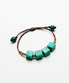 Possibly our most unique Tagua creation yet! Squares of pure tagua seed are dyed vivid hues and strung for a sweet statement. Available in Jade and Salmon.