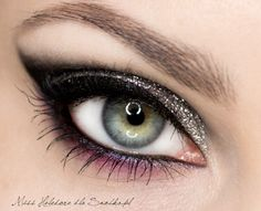 Eye make-up with dark brown sparkles,winged tipd,and purple under liner