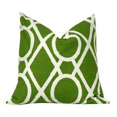 100% Cotton pillow with bamboo lattice motif and feather down fill.   Product: Set of 2 pillowsConstruction Material: Cotton and feather down insertColor: Grass and whiteFeatures:  Zippered closureSame pattern on front and backInsert includedWill enhance any dcor  Dimensions: 20 x 20 eachCleaning and Care: Spot clean with gentle cleaner and air dry