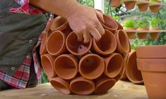 Genius Planter Idea To Add Something Interesting To Your Backyard.This is a really clever planter for planting multiple plants together. Once the plants are in all of these clay pots, they look magnificent! Pots D'argile, Clay Pots, Planter Pots, Planter Ideas, Clay Pot Crafts, Diy Clay, Diy Crafts, Succulent Pots, Succulents Diy