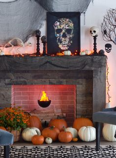 Make the mantle and fireplace the focal point of your Halloween decor with macabre artwork and a smattering of pumpkins picked from the local farm. Featured product includes: SONOMA Goods for Life candle holders, 12-pk. bag of plastic skulls, Americanflat vintage skull framed wall art and hanging flame light. Get set for Halloween at Kohl's.