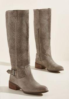Step Up and Out Suede Boot - When an opportunity appears to flaunt these knee high boots, of course you rise to the occasion! A soft, suede pair with trending potential, these taupe kicks encourage you to show off their perforated shafts, western-style stitching, and silver ankle buckles with a strut from the front door to the bold beyond.