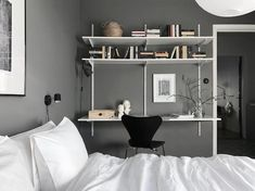Home office using Elfa shelving in the bedroom (dark grey walls). Home office using Elfa shelving in the bedroom (dark grey walls). Blue Green Bedrooms, Blue Gray Bedroom, Gray Bedroom Walls, Wooden Bedroom, Grey Room, Elfa Shelving, Shelves, Grey Bedroom With Pop Of Color, Dark Grey Walls