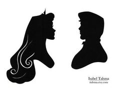 handcut paper silhouettes of Princess Aurora and Prince Phillip from Disney's Sleeping Beauty. Available on Etsy.