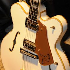 Gretch White Falcon Guitar. If someone buys me this I'll write songs about how awesome you are!