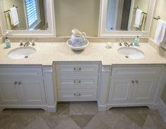 Guest bathroom with Botticino Fiorito marble countertops, eased edge and Botticino Fiorito Marble floors.