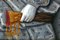 Gold work on glove.