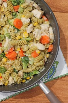 This Cheesy Chicken Veggie Pasta Skillet is an easy one-pot meal that's perfect for weeknight dinners. Just 312 calories or 8 Weight Watchers SmartPoints! www.emilybites.com