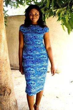 Off shoulder Ankara dress with a high neck line.