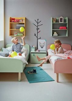 the boo and the boy: shared kids' rooms. Love that they each have their own bookshelves that are different colors! And the neutral gray color for the walls is perfect.