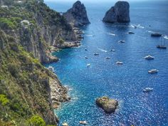 A view of two famous rocks - the ships that go round the island pass right between these rocks - 10 photos that will make you want to visit Capri, Italy