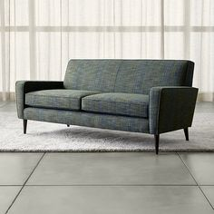 Shop Torino Blue Modern Apartment Sofa.   In this charismatic take on the straightforward confident look of the 50s, the sofa has a now-and-then appeal with a chunky teal and avocado weave and a hint of mustard.