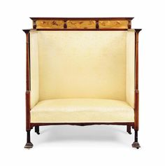 AN EDWARDIAN INLAID MAHOGANY AND UPHOLSTERED HIGH-BACK SETTLE -  CIRCA 1910
