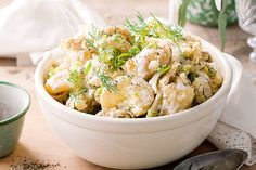 A+tangy+dressing+and+crunchy+fennel+slices+shine+in+this+smashed+potato+salad.