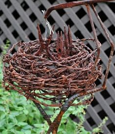 Bird's nest of repurposed barbed wire and pliers. By Pam Penick, 2011.