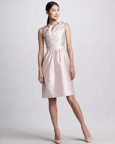 Carmen Marc Valvo creates an elegant, soft pink cocktail dress with a tulip ruffled neckline and hint of black underlay-classic combination. Asymmetric neckline with tulip ruffles and... More Details