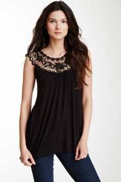 """Scoop Lace Neck Blouse in black by Simply Irresistable $58 - $15 @HauteLook. Scoop lace neck. Cap sleeves. 28"""" length. Model's stats: - Height: 5'9"""" - Hips: 34.5"""" - Bust: 32"""" - Waist: 24"""" Model is wearing size S. 95% rayon, 5% spandex. Dry clean."""