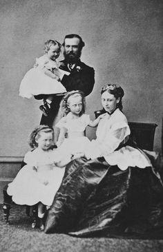 Princess Elizabeth, seated; Prince Louis standing, holding Princess Irene; Princess Victoria standing, her left hand on her mother's right shoulder; and Princess Alice, seated 3/4 left; she holds one of Pss Elizabeth's hands.
