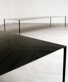 Amazing table designed for Established & Sons by Terence Woodgate and John Barnard. Made of layered carbon fibre.