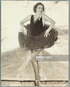 American actress and film star Joan Crawford poses in ballerina costume and ballet slippers