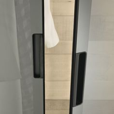 cover is defined by the idea of making doors the only structural element of the cabinet
