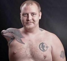 Injury into Inspiration Dolphin Tattoo