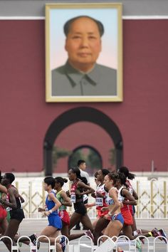 World Athletics Championships 2015: day nine – in pictures   Sport   Athletes run past a portrait of Mao Zedong in Tiananmen Square as they compete in the final of the women's marathon