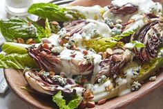 A healthier wedge salad recipe with smoked almonds and low-fat dressing by Giada De Laurentiis