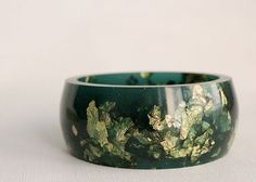 emerald green resin round bangle made with eco resin containing metallic gold leaf foil Pine Oil, Resin Uses, Eco Resin, Bangles Making, Gold Leaf, Metallic Gold, Jewel Tones, Emerald Green, Bracelet Watch