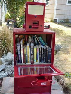 Little Free Library #1967 | Flickr. What a great idea to use an old newspaper vending machine.