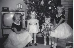 Hmmmmm, I remember Christmases that looked something like this - only, thank God, Mom didn't dress us up like for photos....