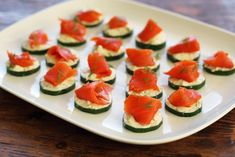 Cucumber Bites with Herbed Cheese and Smoked Salmon are a simple, elegant and beautiful, three ingredient appetizer! Perfect for entertaining.
