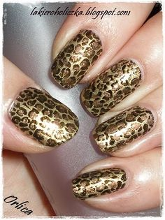Trying to show the animal within, why not try some cheetah print nails? I've done these before but instead of gold I used shades of pink. You need two shades of the same color (one lighter, one darker) and then black or brown. Apply a the light-colored base coat. Take a tooth pick and dip it into the darker polish and make some uneven dots on your nails. Take another toothpick and dip it into the black or brown and make a line around the dots. Let it dry and be amazed at your skills! -SvH