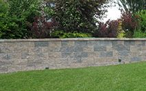 CornerStone® Retaining Wall- CornerStone® offers an attractive sound and environmentally friendly wall that can be used in residential landscaping walls and large commercial projects. The system uses three components that interconnect using apatented, mortarless, SecureLug interlock system rather than expensive, time consuming pins or clips.