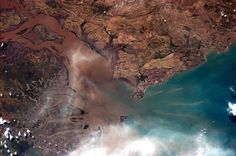 Chris Hadfield@Cmdr_Hadfield  |  Australian river mouth - an explosion of colour and texture.   | Jan 26, 2013