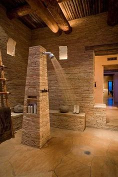 Stone and Wood Bathroom Design with Open Shower, Stone Bathtub and Fireplace