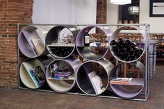 LIBRA, Wine and Bookshelf by CAPOLINEA DESIGN- made of cellulose tubes, recycled wood and iron water–pipes: http://www.archello.com/en/product/libra-wine-and-bookshelf #Interior #Wine #Books