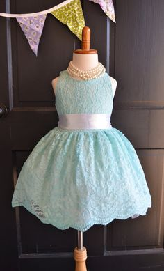 Beautiful little girls special occasion dress. Made of antique-looking aqua/turquoise bridal lace, has a simple satin sash. This dress is fully lined and zips in back. Perfect for your next special event.