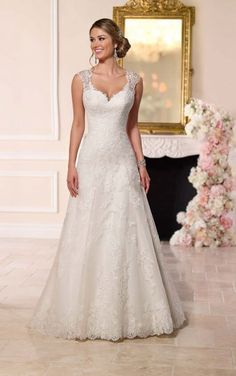 6219 A-Line Sweetheart Wedding Dress by Stella York. A-line with v-neck and natural waist. Cathedral train. Lace fabric