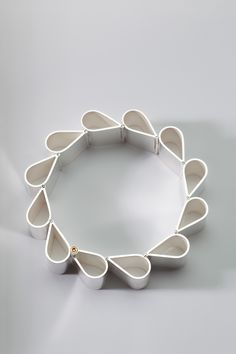 "Sterling silver hinged bracelet, titled ""Ribbon 2"" by Sorcha O'Horain: I like the way this reminds me of book pages, and it would give me a lot of practice with hinges!"