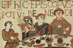 """Bayeux Tapestry, depicting Roger de Beaumont with beard, William the Conqueror seated to his left, and Bishop Odo, half-brother of William, to the left of William, blessing the food at the feast table.  The Bayeux Tapestry was created in the 11th century to commemorate the invasion of England by William the Conqueror, Duke of Normandy, and his victory at the Battle of Hastings in 1066.  The tapestry is 230 feet long and about 20"""" wide.  It is on permanent display at the museum in Bayeux…"""