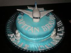 Heres our wedding cake with a pig as a pilot( all those who know me will get it)!!