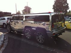 Chrome hummer limo. Wedding limos, SUV- transportation for bride groom and wedding party!