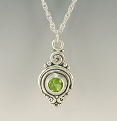 P736- Sterling Silver Pendant with a 6 mm Faceted Peridot. Has a Sterling Silver 18 1.9 mm Double Rope chain with Lobster Claw Closure. Pendant measures: 27 mm L x 14 mm W. It is made using the Lost wax method of casting, where I made the design in wax and then cast it into silver. To learn more about this process and Me please visit my website at: www.denimanddiamondsjewelry.com Thanks for stopping by, come back often. Patti